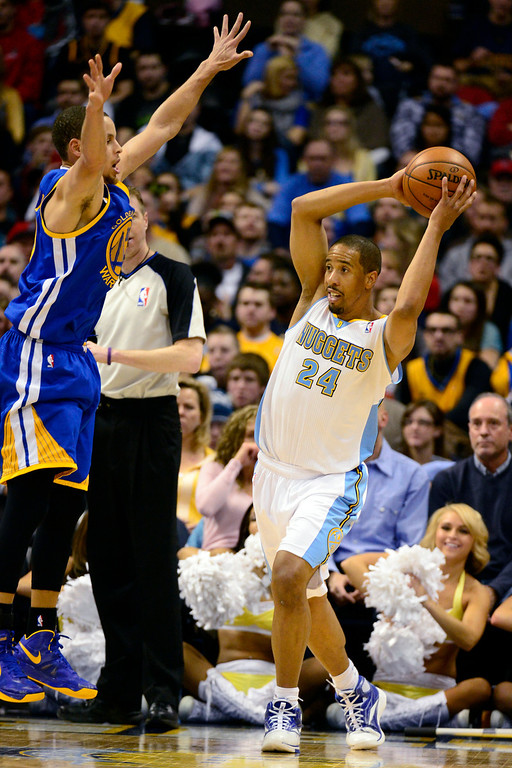 Description of . Denver Nuggets point guard Andre Miller (24) looks for an open teammate as Golden State Warriors point guard Stephen Curry (30) defends during the second half of the Nuggets' 116-105 win at the Pepsi Center on Sunday, January 13, 2013. AAron Ontiveroz, The Denver Post