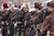 Kazakh hunters stay with their tame golden eagles before an annual hunting competition in Chengelsy Gorge, some 150 km (93 miles) east of Almaty February 22, 2013. Picture taken February 22, 2013.  REUTERS/Shamil Zhumatov