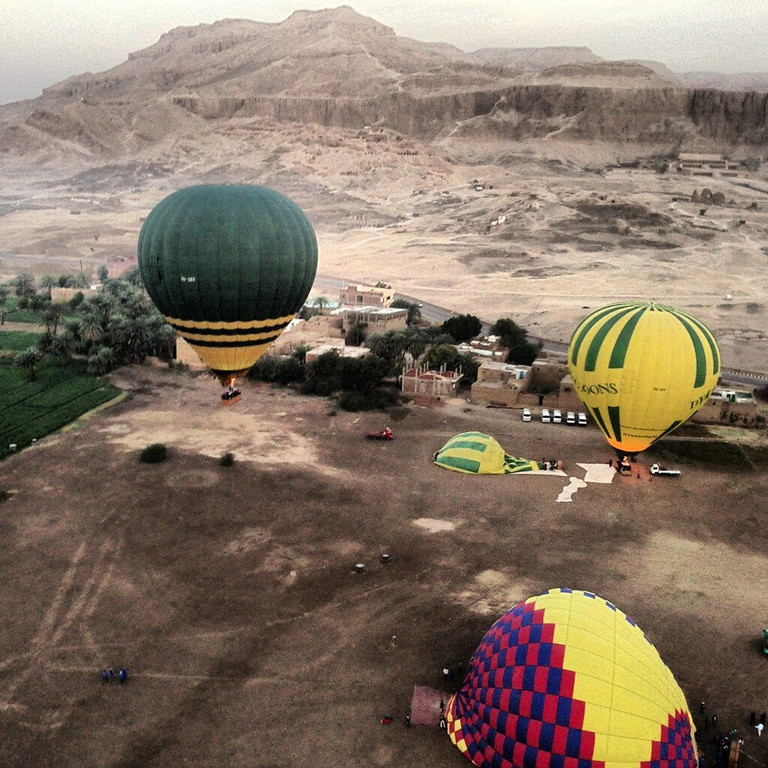 Description of . In this image made available by Christopher Michel, the launch site near Luxor in Egypt, shortly prior to a hot air balloon explosion which killed at least 18 tourists including a number of tourists Tuesday Feb. 26, 2013. Witnesses described hearing a loud explosion before seeing plumes of smoke as the balloon caught fire and plunged into a sugar cane field west of Luxor, which is 320 miles (510km) south of the capital Cairo. The casualties are believed to include British and French tourists, as well as other nationalities, a security official in the country said. (AP Photo/Christopher Michel)