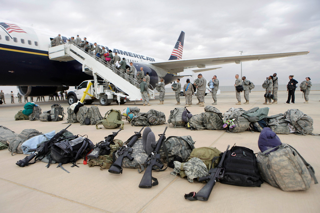 Description of . U.S. soldiers begin their journey home at al-Asad airbase, west of Baghdad, Iraq, Tuesday, Nov. 1 , 2011. The U.S. has promised to withdraw from Iraq by the end of the year as required by a 2008 security agreement between Washington and Baghdad. Some 39,000 U.S. troops are scheduled to clear out along with their equipment. (AP Photo/Khalid Mohammed)