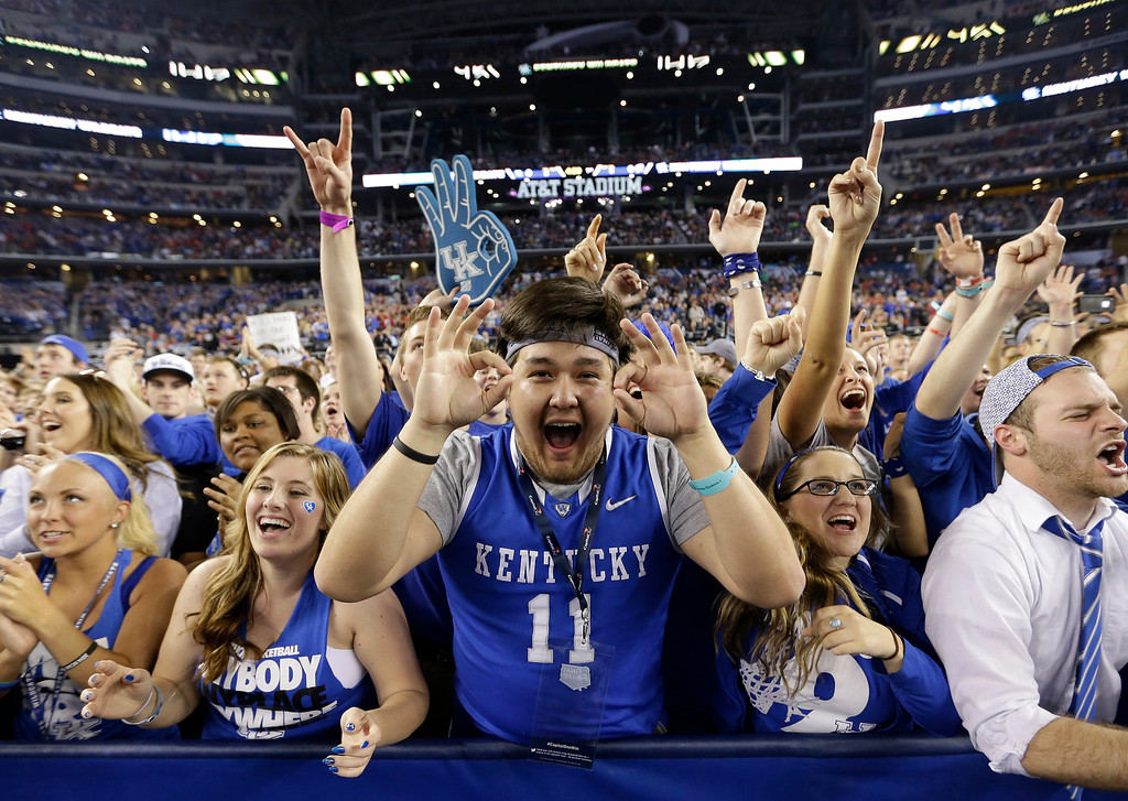 Description of . Kentucky fans cheer before their game against Wisconsin at their NCAA Final Four tournament college basketball semifinal game Saturday, April 5, 2014, in Arlington, Texas. (AP Photo/David J. Phillip)