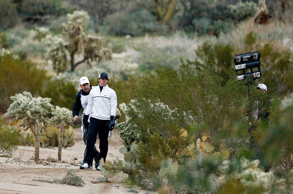 Description of . Northern Ireland\'s Rory McIlroy makes his way down to the 17th fairway after teeing off against Shane Lowry in the first round during the Match Play Championship golf tournament, Thursday, Feb. 21, 2013, in Marana, Ariz. (AP Photo/Ross D. Franklin)