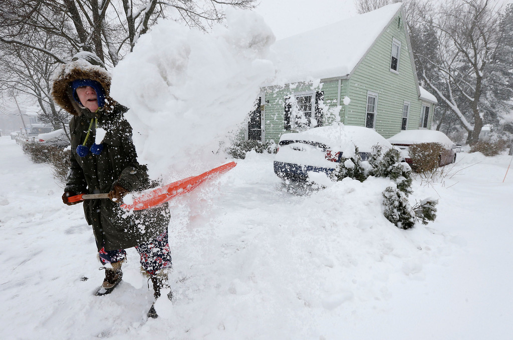 Description of . Peggy Udden, of Norwood, Mass., shovels her driveway in Norwood, Wednesday, Feb. 5, 2014. Six to 12 inches of snow is expected around Boston, with 3 to 6 inches in southeastern areas before changing to sleet and rain Wednesday. (AP Photo/Steven Senne)
