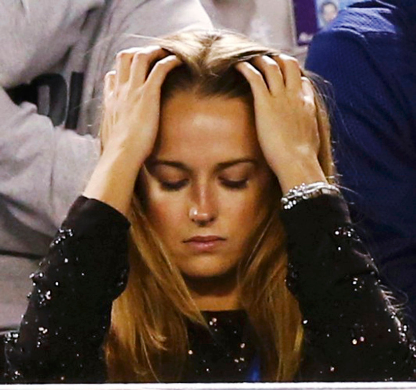 Description of . Kim Sears, girlfriend of Andy Murray of Britain, watches his men\'s singles final match against Novak Djokovic of Serbia at the Australian Open tennis tournament in Melbourne January 27, 2013. Djokovic became the first man to win three successive Australian Open titles in the professional era when he defeated Murray on Sunday.  REUTERS/Tim Wimborne