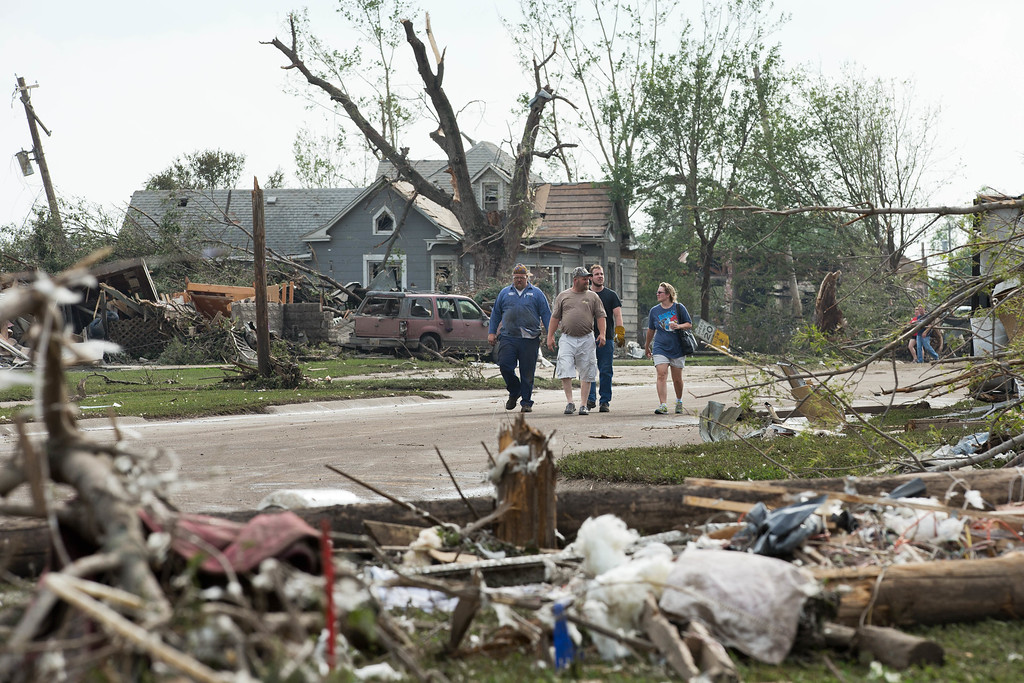 Description of . People survey the damage caused by a tornado that hit Pilger, Neb.,  on Monday, June 16, 2014.  The National Weather Service says the storm that struck northeast Nebraska appears to have produced four tornadoes, one of which ravaged the town of Pilger.   (AP Photo/The World-Herald, Ryan Soderlin)