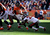 Denver Broncos wide receiver Eric Decker #87 pulls in a first down catch and is taken down by Tampa Bay Buccaneers cornerback E.J. Biggers #31 during the first quarter.  The Denver Broncos vs The Tampa Bay Buccaneers at Sports Authority Field Sunday December 2, 2012. Tim Rasmussen, The Denver Post