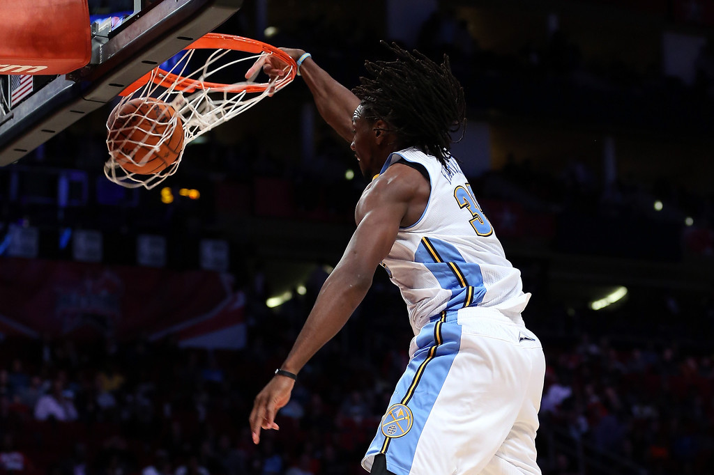 Description of . HOUSTON, TX - FEBRUARY 15:  Kenneth Faried #35 of the Denver Nuggets and Team Chuck dunks the ball in the second half in the BBVA Rising Stars Challenge 2013 part of the 2013 NBA All-Star Weekend at the Toyota Center on February 15, 2013 in Houston, Texas.  (Photo by Ronald Martinez/Getty Images)