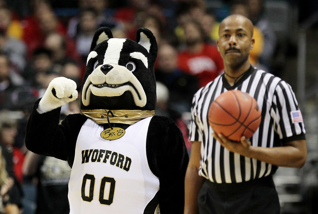 Description of . The Wofford Terriers mascot looks on against the Michigan Wolverines during the second round of the 2014 NCAA Men's Basketball Tournament at BMO Harris Bradley Center on March 20, 2014 in Milwaukee, Wisconsin.  (Photo by Mike McGinnis/Getty Images)