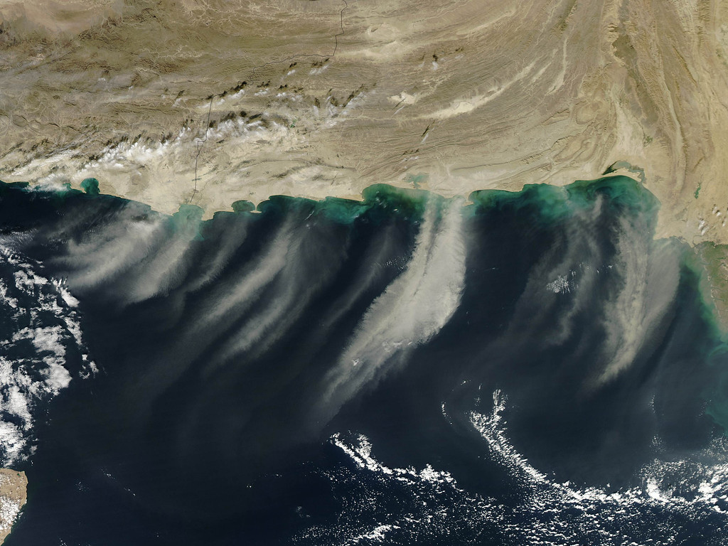 Description of . Multiple dust plumes are seen blowing off the coasts of Iran and Pakistan in this NASA handout image taken November 29, 2012 and released December 3, 2012.  These images document the movement of the plumes southward over the Arabian Sea.  REUTER/NASA/Jeff Schmaltz/Handout