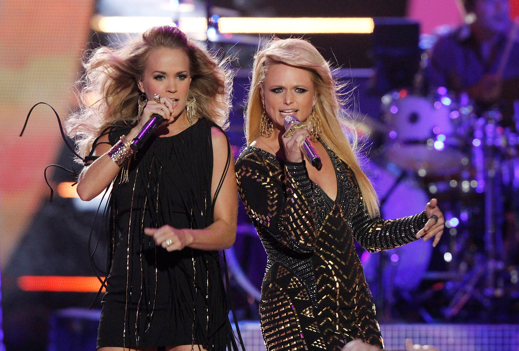 Description of . Carrie Underwood, left, and Miranda Lambert perform on stage at the CMT Music Awards at Bridgestone Arena on Wednesday, June 4, 2014, in Nashville, Tenn. (Photo by Wade Payne/Invision/AP)