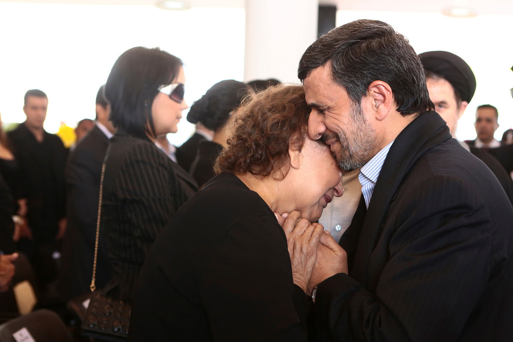 Description of . Iran's President Mahmoud Ahmadinejad (R) offers his condolences to Elena Frias, mother of Venezuela's late President Hugo Chavez, during the funeral service at the Military Academy in Caracas March 8, 2013, in this picture provided by the Miraflores Palace. REUTERS/Miraflores Palace/Handout