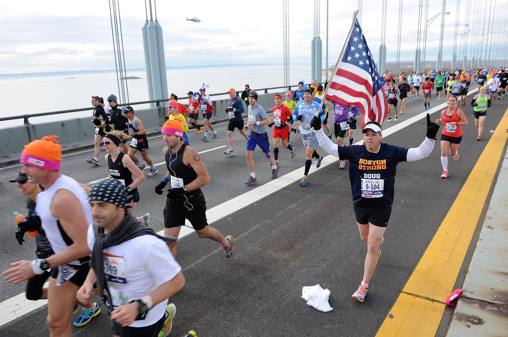 Description of . Runners cross the Verrazano-Narrows Bridge at the start of the ING New York City Marathon on November 3, 2013 in the Brooklyn borough of New York City.  (Photo by Maddie Meyer/Getty Images)