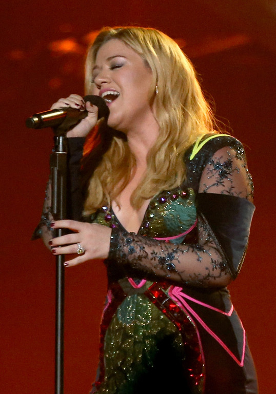 "Description of . LOS ANGELES, CA - DECEMBER 16:  Singer Kelly Clarkson performs onstage during ""VH1 Divas\"" 2012 at The Shrine Auditorium on December 16, 2012 in Los Angeles, California.  (Photo by Christopher Polk/Getty Images)"