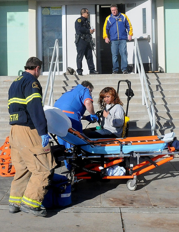 Description of . This image provided by the Taft Midway Driller/Doug Keeler shows paramedics assisting a student wounded during a shooting Thursday Jan. 10, 2013 at San Joaquin Valley high school in Taft, Calif. Authorities said a student was shot and wounded and another student was taken into custody. (AP Photo/Taft  Midway Driller, Doug Keeler)