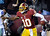 Washington Redskins quarterback Robert Griffin III (10) celebrates his touchdown during the second half of an NFL football game against the Dallas Cowboys on Sunday, Dec. 30, 2012, in Landover, Md. (AP Photo/Nick Wass)