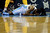 Denver Nuggets small forward Kenneth Faried (35) hits the deck after colliding with Los Angeles Lakers center Dwight Howard (12) during the second half of the Nuggets' 126-114 win at the Pepsi Center on Wednesday, December 26, 2012. Howard was ejected following the play. AAron Ontiveroz, The Denver Post