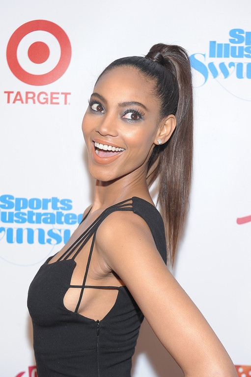 Description of . NEW YORK, NY - FEBRUARY 12:  Model Ariel Meredith attends as Sports Illustrated celebrates SI Swimsuit 2013 with a star-studded red carpet kickoff event at Crimson on February 12, 2013 in New York City.  (Photo by Michael Loccisano/Getty Images for Sports Illustrated)