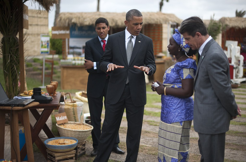 Description of . US President Barack Obama (2nd L) speaks on June 28, 2013 with the head of the Senegalese Federation of Corn Producers, Nimna Diayte (2nd R), before USAID administrator Raj Shah (L) during an event on food security in Dakar. Obama flies to South Africa later on June 27 to pay homage to his former President Nelson Mandela, who is fighting for his life in hospital. JIM WATSON/AFP/Getty Images