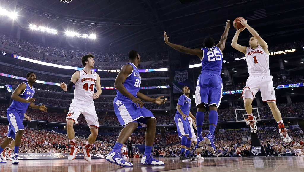 Description of . Wisconsin guard Ben Brust (1) shoots over Kentucky guard Dominique Hawkins (25) during the first half of an NCAA Final Four tournament college basketball semifinal game Saturday, April 5, 2014, in Arlington, Texas. (AP Photo/David J. Phillip)