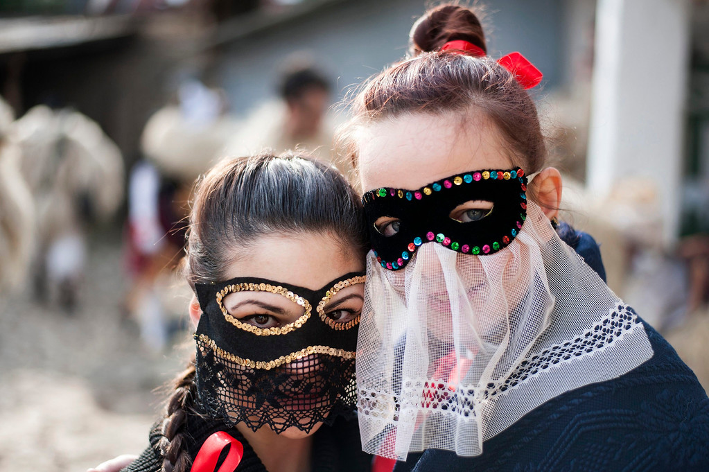 Description of . Young revelers wearing masks get ready for the traditional carnival parade in the yard of a house in Mohacs, 189 kms south of Budapest, Hungary, 27 February 2014.   EPA/TAMAS SOKI