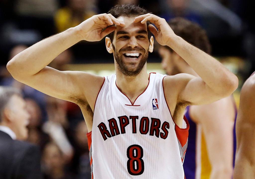 Description of . Toronto Raptors' Jose Calderon smiles during a break against the Los Angeles Lakers during the second half of their NBA basketball game in Toronto, January 20, 2013. REUTERS/Mark Blinch