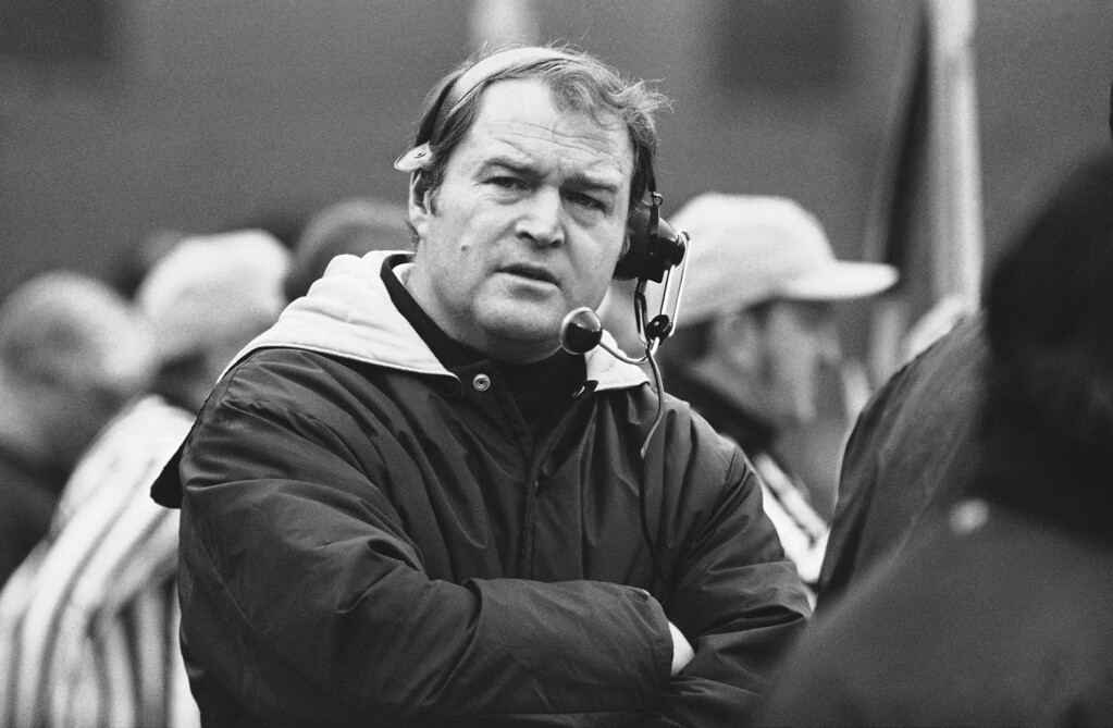 Description of . Pittsburgh Steelers head coach Chuck Noll, left, keeps in touch with his spotters during game against the Oakland Raiders in the American Conference playoff game in Pittsburgh, Dec. 23, 1972. John Madden, right, Oakland Raiders head coach puts hand to face watching. (AP Photo)