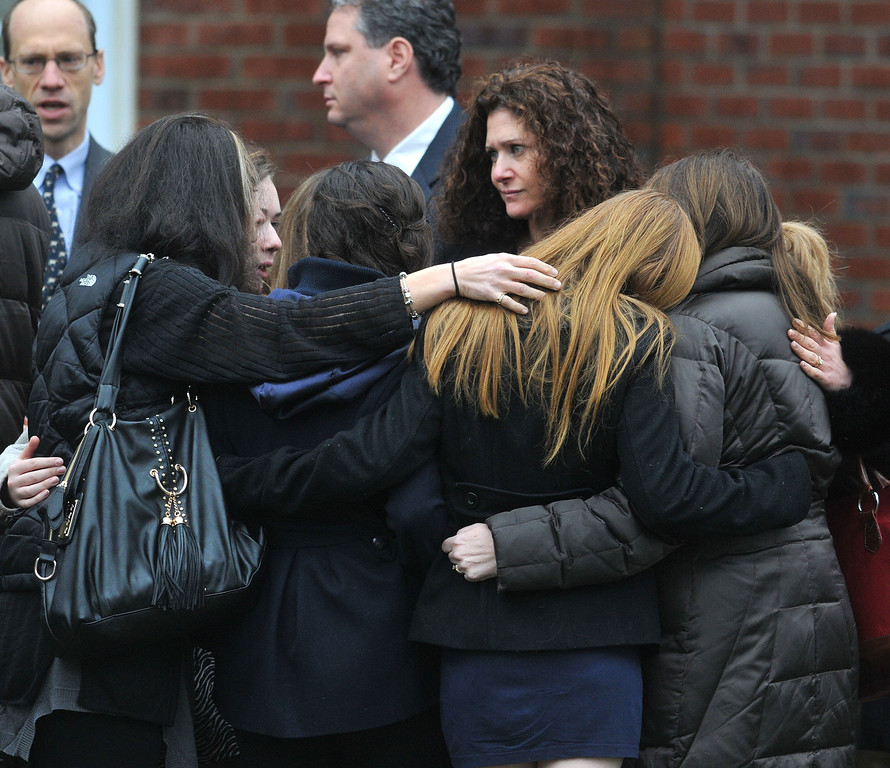 Description of . Fairfield--Mourners arrive at the Abraham L. Green & Son Funeral Home in Fairfield for the funeral for Noah Pozner, 6, victim of the Sandy Hook Elementary School massacre. Photo-Peter Casolino 12/17/12  ,