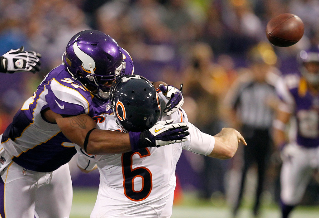 Description of . Chicago Bears quarterback Jay Cutler (6) gets hit by Minnesota Vikings defensive end Everson Griffen, left, after passing the ball during the second half of an NFL football game Sunday, Dec. 9, 2012, in Minneapolis. Griffen was called for a personal foul on the play. (AP Photo/Genevieve Ross)
