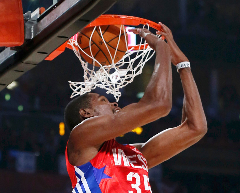 Description of . NBA All-Star Kevin Durant of the Oklahoma Thunder does a reverse dunk during the NBA All-Star basketball game in Houston, Texas, February 17, 2013. REUTERS/Lucy Nicholson