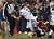 Russell Wilson #3 of the Seattle Seahawks is sacked by  Josh Wilson #26 of the Washington Redskins in the third quarter during the NFC Wild Card Playoff Game at FedExField on January 6, 2013 in Landover, Maryland.  (Photo by Win McNamee/Getty Images)