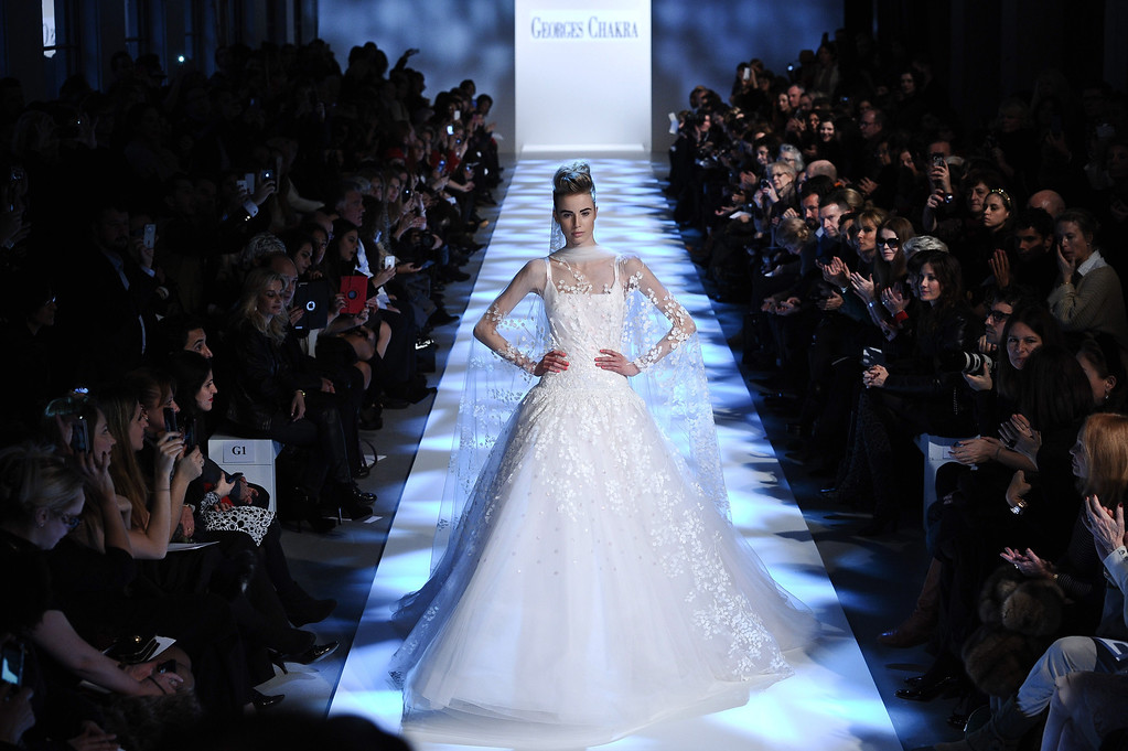 Description of . A model wears a creation by fashion designer Georges Chakra as part of his Spring/Summer 2013 Haute Couture fashion collection, in Paris, Wednesday, Jan. 23, 2013. (AP Photo/Zacharie Scheurer)