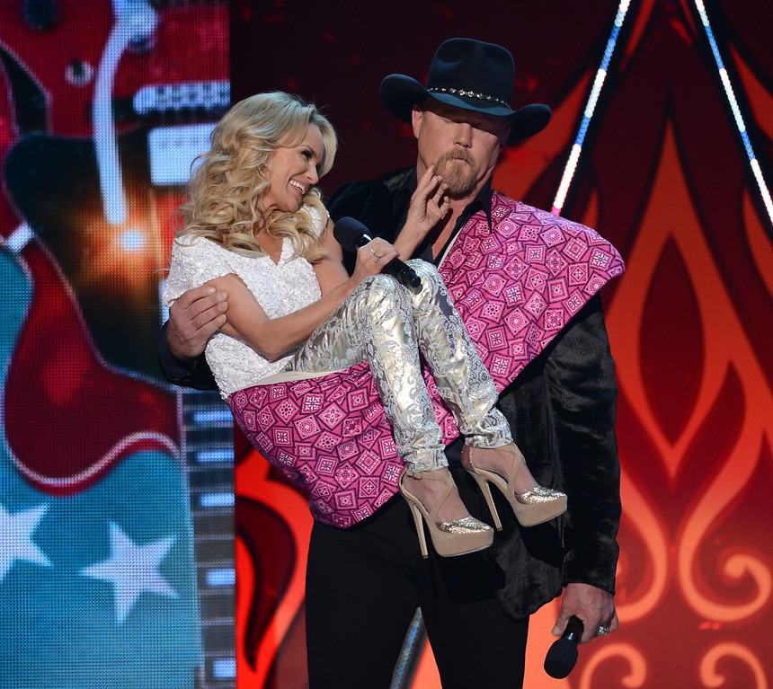Description of . LAS VEGAS, NV - DECEMBER 10:  Hosts Kristin Chenoweth (L) and Trace Adkins speak onstage during the 2012 American Country Awards at the Mandalay Bay Events Center on December 10, 2012 in Las Vegas, Nevada.  (Photo by Mark Davis/Getty Images)