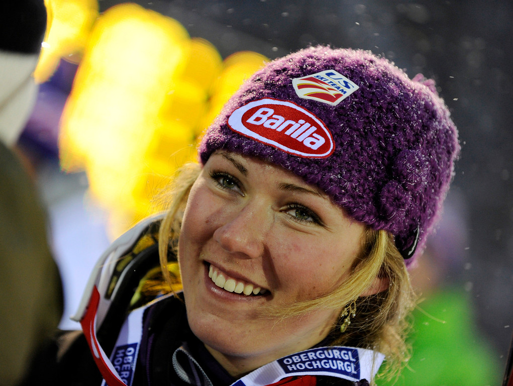 Description of . Mikaela Shiffrin, of the United States, smiles after finishing third in a alpine ski, women's World Cup Slalom, in Levi, Finland, Saturday, Nov.10, 2012. Olympic champion Maria Hoefl-Riesch of Germany overcame a nagging hip injury and local favorite Tanja Poutiainen on Saturday, putting down a blazing second run to overtake the Finn and win the first women's World Cup slalom of the season. (AP Photo/Giovanni Auletta)