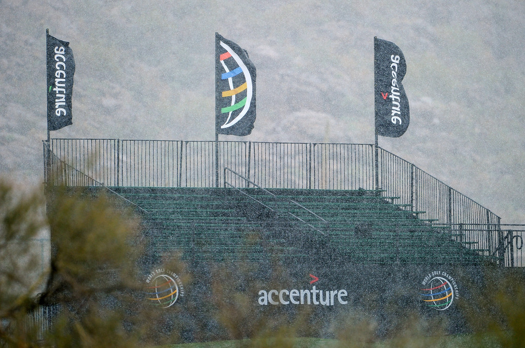 Description of . MARANA, AZ - FEBRUARY 20:  Snow falls on empty bleachers as play was suspended due to weather during the first round of the World Golf Championships - Accenture Match Play at the Golf Club at Dove Mountain on February 20, 2013 in Marana, Arizona.  (Photo by Stuart Franklin/Getty Images)