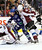 Vancouver Canucks' Alexandre Burrows (C) is stopped by Colorado Avalanche goaltender Semyon Varlamov and Ryan O'Byrne (R) during the first period of their NHL hockey game in Vancouver, British Columbia January 30, 2013.   REUTERS/Ben Nelms