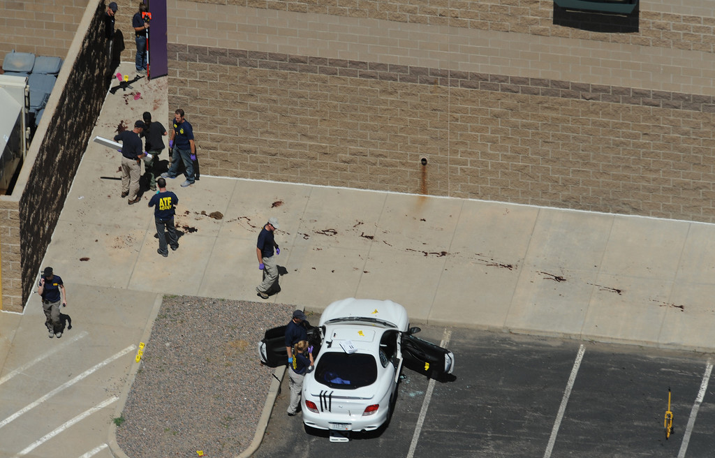 Description of . A trail of blood is left after people fled a mass shooting at The Century 16 movie theater in Aurora. 12 people were killed and 58 people wounded when James Holmes fired shots into a crowded theater during the midnight premiere of the new Batman movie. Helen H. Richardson, The Denver Post