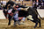DENVER, CO. - JANUARY 21:  Joe Stover loses his grip on his bull during the bull riding performance at the National Western Stock Show Martin Luther King Heritage Rodeo January 21, 2013