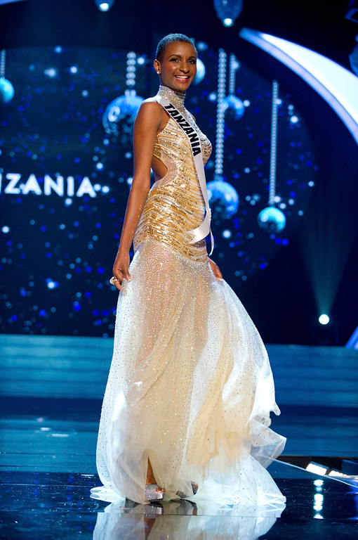 Description of . Miss Tanzania 2012 Winfrida Dominic competes in an evening gown of her choice during the Evening Gown Competition of the 2012 Miss Universe Presentation Show in Las Vegas, Nevada, December 13, 2012. The Miss Universe 2012 pageant will be held on December 19 at the Planet Hollywood Resort and Casino in Las Vegas. REUTERS/Darren Decker/Miss Universe Organization L.P/Handout