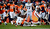 Denver Broncos cornerback Chris Harris (25) takes down Cleveland Browns wide receiver Greg Little (15) early in the third quarter.  The Denver Broncos vs Cleveland Browns at Sports Authority Field Sunday December 23, 2012. AAron Ontiveroz, The Denver Post