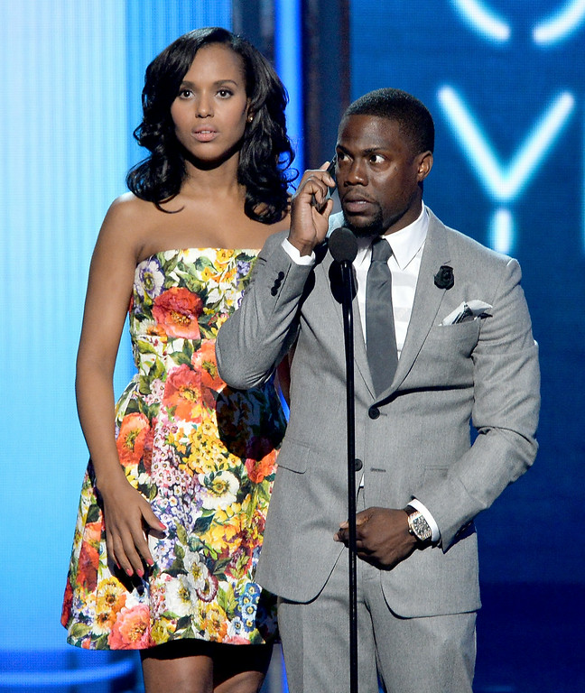 Description of . Actors Kerry Washington (L) and Kevin Hart speak onstage during the BET AWARDS '14 at Nokia Theatre L.A. LIVE on June 29, 2014 in Los Angeles, California.  (Photo by Kevin Winter/Getty Images for BET)