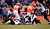 Denver Broncos running back Jacob Hester (40) works his way though the pile to gain a first down during the first half.  The Denver Broncos vs Baltimore Ravens AFC Divisional playoff game at Sports Authority Field Saturday January 12, 2013. (Photo by John Leyba,/The Denver Post)