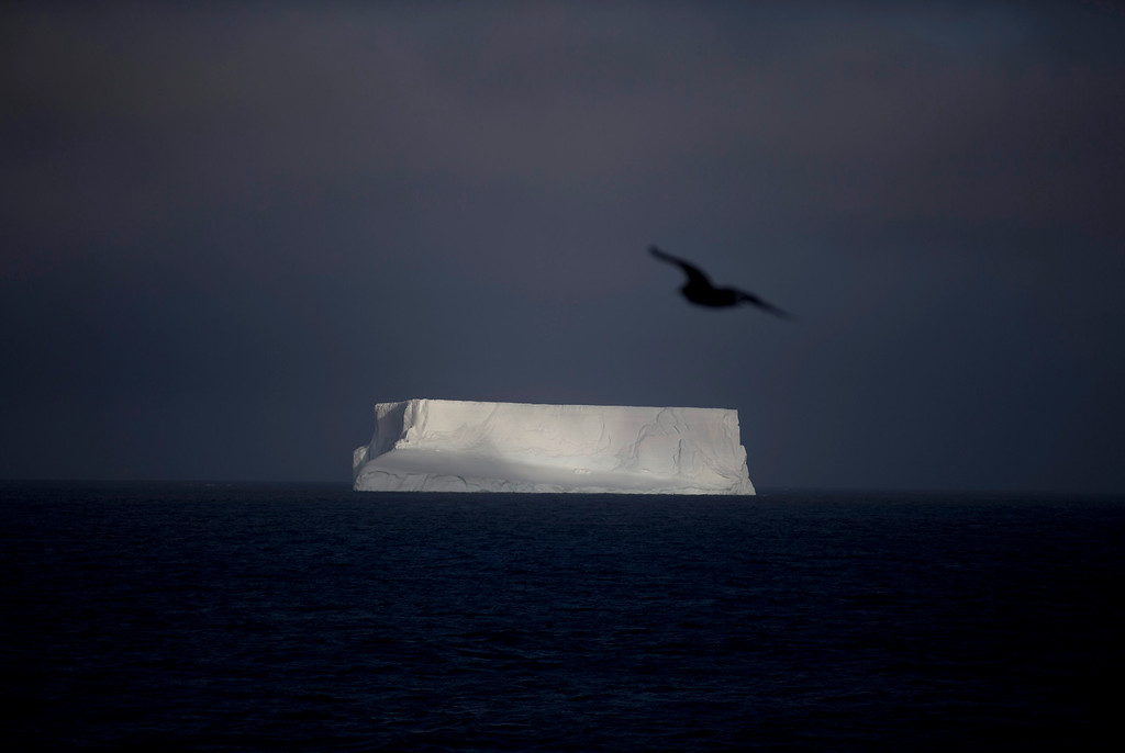 Description of . In this Jan. 27, 2015 photo, an iceberg floats in the Bahia Almirantazgo near Livingston Island, part of the South Shetland Island archipelago in Antarctica. Antarctica conjures up images of quiet mountains and white plateaus, but the coldest, driest and remotest continent is far from dormant. The majority of it is covered by ice, and that ice is constantly moving. (AP Photo/Natacha Pisarenko)