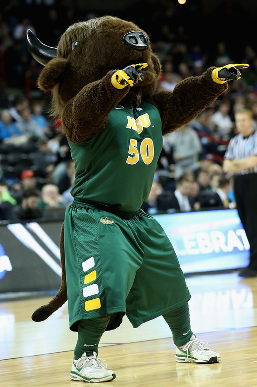 Description of . The North Dakota State Bison mascot, Thundar performs during haltime in the second round of the 2014 NCAA Men's Basketball Tournament game against the Oklahoma Sooners at Spokane Veterans Memorial Arena on March 20, 2014 in Spokane, Washington.  (Photo by Stephen Dunn/Getty Images)