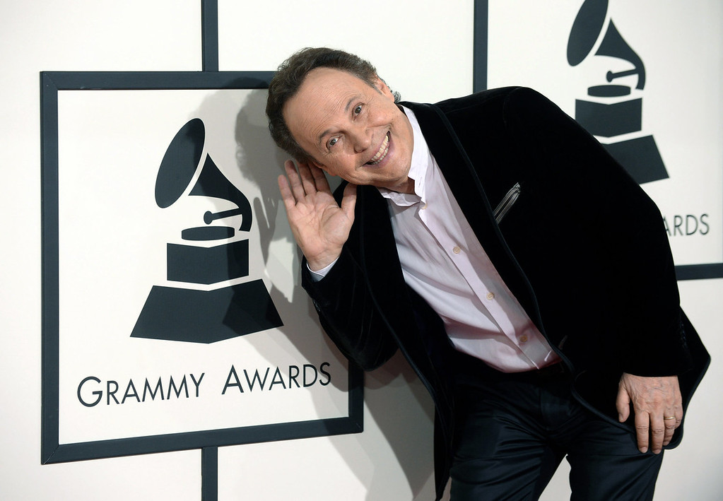 Description of . Billy Crystal arrives for the 56th annual GRAMMY Awards at Staples Center on Sunday, Jan. 26, 2014, in Los Angeles. (Photo by Jordan Strauss/Invision/AP)