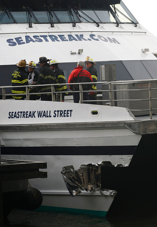 Description of . New York City emergency personnel talk on the deck of a commuter ferry that crashed during the morning rush in New York, January 9, 2013. A commuter ferry crashed into a pier in lower Manhattan early Wednesday, injuring 57 people, one critically, the New York City Police Department said. Passengers lying on stretchers littered the pier near South Street Seaport, attended to by firefighters and rescue workers who rushed to the scene of the 8:43 a.m. (1343 GMT) hard landing. REUTERS/Brendan McDermid