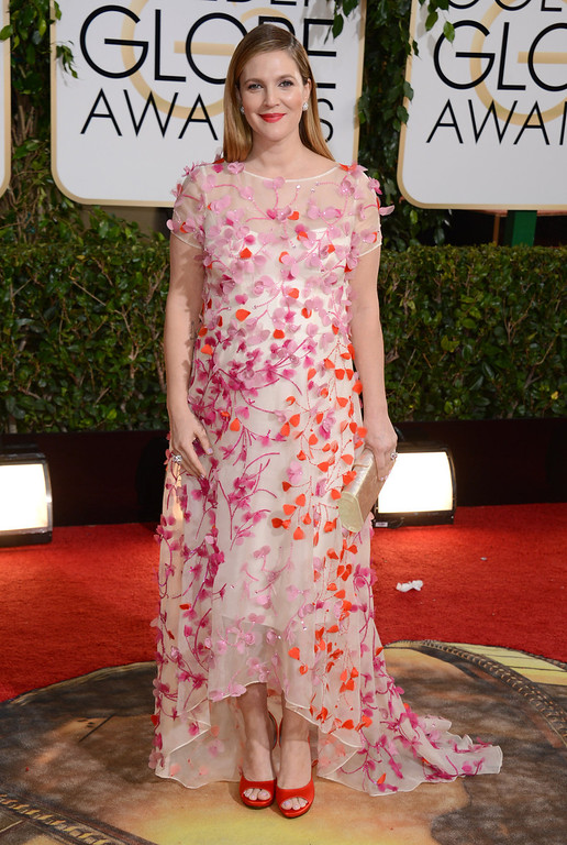 Description of . Drew Barrymore arrives at the 71st annual Golden Globe Awards at the Beverly Hilton Hotel on Sunday, Jan. 12, 2014, in Beverly Hills, Calif. (Photo by Jordan Strauss/Invision/AP)