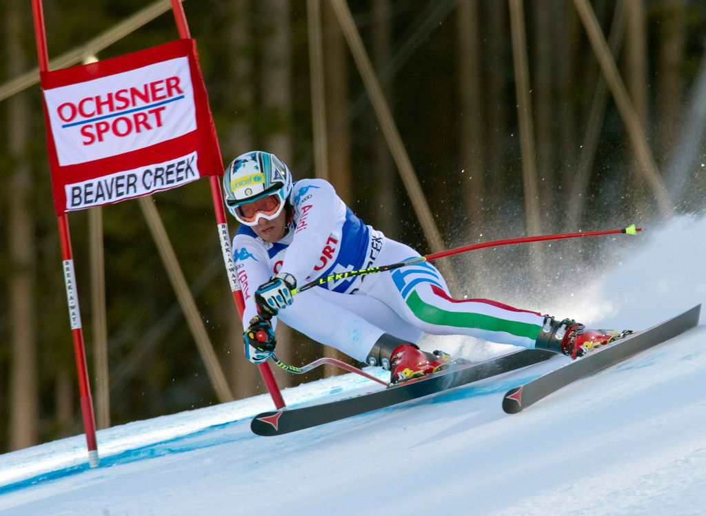 Description of . Werner Heel from Italy, speeds down the course during the men's World Cup super-g ski race in Beaver Creek, Colo., on Saturday, Dec. 1, 2012. (AP Photo/Nathan Bilow)