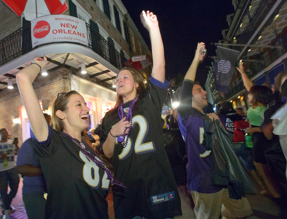 Description of . Baltimore Ravens fans celebrate the team\'s victory as fans from the Ravens and San Francisco 49ers NFL football teams pack the French Quarter on Bourbon Street for Super Bowl XLVII in New Orleans, Sunday, Feb. 3, 2013. (AP Photo/Matthew Hinton)