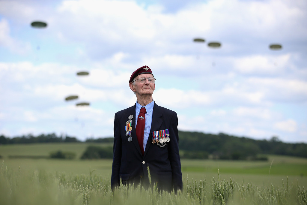 Description of . Fred Glover, aged 88, a veteran of the 9th Para Battalian watches a parachute jump just outside Rainville during D-Day 70 Commemorations on June 5, 2014 in Ranville, France. Friday 6th June is the 70th anniversary of the D-Day landings which saw 156,000 troops from the allied countries including the United Kingdom and the United States join forces to launch an audacious attack on the beaches of Normandy,  these assaults are credited with the eventual defeat of Nazi Germany. A series of events commemorating the 70th anniversary are planned for the week with many heads of state traveling to the famous beaches to pay their respects to those who lost their lives.  (Photo by Chris Jackson/Getty Images)