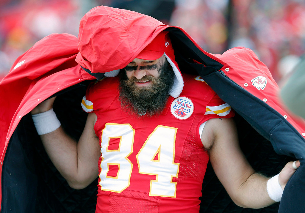 Description of . Kansas City Chiefs tight end Sean McGrath (84) puts on a coat during the first half of an NFL football game against the San Diego Chargers in Kansas City, Mo., Sunday, Nov. 24, 2013. (AP Photo/Ed Zurga)